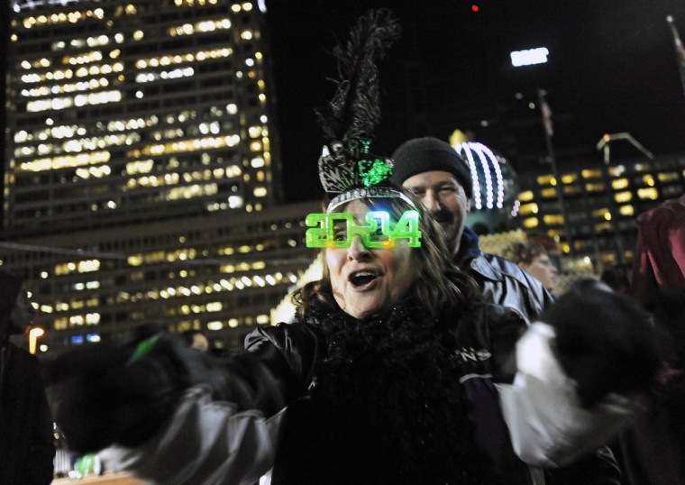 Rose Ettlin and husband John Kelly, of Baltimore dance to the music of Alter Ego during New Year's eve celebration at the Inner Harbor to welcome in 2014. (Kenneth K. Lam/Baltimore Sun)