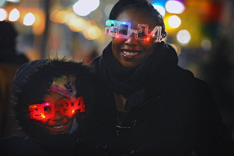 Londyn Jones, 9, of Baltimore, and mother Danielle got their 2014 eye glasses ready as they celebrate New Year's eve at the Inner Harbor to welcome in 2014. (Kenneth K. Lam/Baltimore Sun)