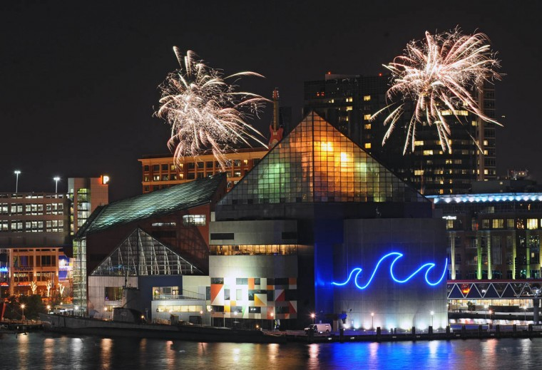 The National Aquarium in Baltimore shoots off small fireworks on the hours ahead of the New Year's Eve Spectacular fireworks show at the Inner Harbor to welcome in the year 2014. (Kenneth K. Lam/Baltimore Sun)