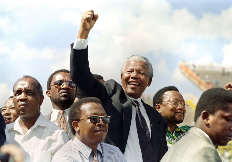 A file photo taken on March 15, 1994 shows the President of the African National Congress (ANC) Nelson Mandela raising a clenched fist to supporters upon his arrival for an election rally ahead of the April 27 general elections in Mmabatho. South Africans will vote 27 April 1994 in the country's first democratic and multiracial general elections. (Walter Dhladhla/AFP/Getty Images)