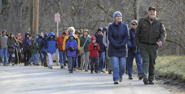 Max Buffington, right, a volunteer ranger with the Maryland Park Service leads the hike through Patapsco Park. His wife, Patty Buffington walks next to him. The State Department of Natural Resources kicks off 2014 with First Day Hikes. This one is in the Patapsco Valley State Park's Daniels area. (Lloyd Fox/Baltimore Sun)