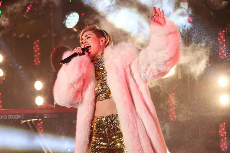 Miley Cyrus performs on stage ahead of midnight at The New Year's Eve 2014 Celebration in Times Square in New York City. (Neilson Barnard/Getty Images)