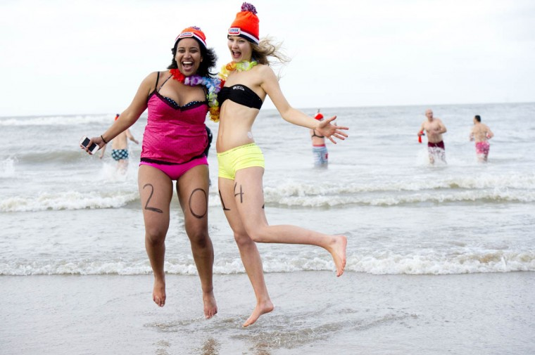 Two women take part in the traditional sea bathing to mark the start of the new year in Scheveningen. (Robin Utrecht/Getty Images)