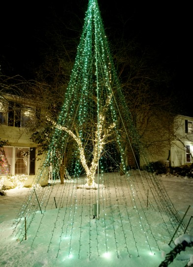 "The holiday light ""tree"" is the featured attractive of Phil Hoesch's light display at his parents' Cockeysville home. The tree has 6,500 lights and they are change colors when choreographed to music. (Jon Sham/BSMG)"