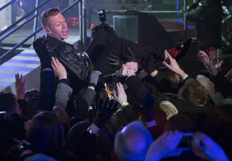 Rapper Ben Haggerty, known by his stage name Macklemore, crowd surfs during New Year's Eve celebrations in Times Square in New York. (Carlo Allegri/Reuters photo)