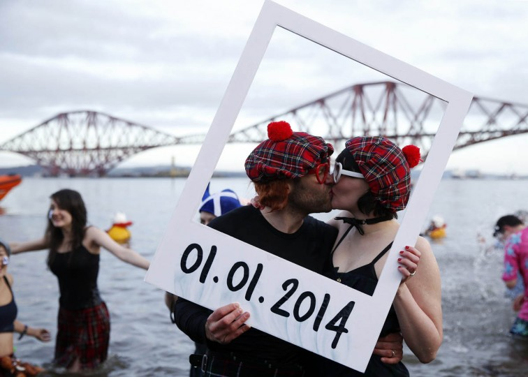 Swimmers in fancy dress participate in the New Year's Day Looney Dook swim at South Queensferry, Scotland. (Russell Cheyne/Reuters photo)