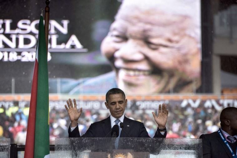 US President Barack Obama arrives to deliver a speech during the memorial service for late South African President Nelson Mandela at Soccer City Stadium in Johannesburg on December 10, 2013. Mandela, the revered icon of the anti-apartheid struggle in South Africa and one of the towering political figures of the 20th century, died in Johannesburg on December 5 at age 95. Mandela, who was elected South Africa's first black president after spending nearly three decades in prison, had been receiving treatment for a lung infection at his Johannesburg home since September, after three months in hospital in a critical state. (Brendan Smialowski/AFP/Getty Images)