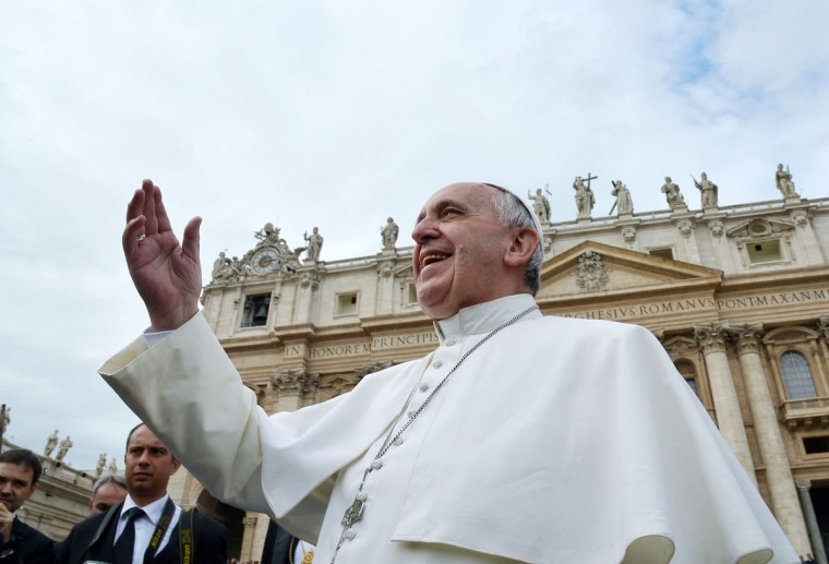 Pope Francis smiles at pilgrims in Saint Peter's square at the Vatican, during the end of his weekly general audience on November 13, 2013. (Alberto Pizzoli/AFP/Getty Images)