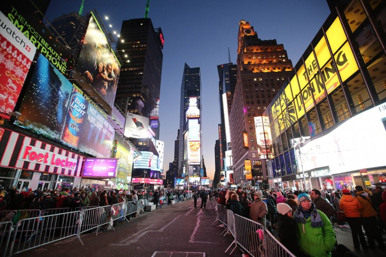 New Year's Eve revelers gather hours ahead of midnight at The New Year's Eve 2014 Celebration in Times Square in New York City. (Neilson Barnard/Getty Images)