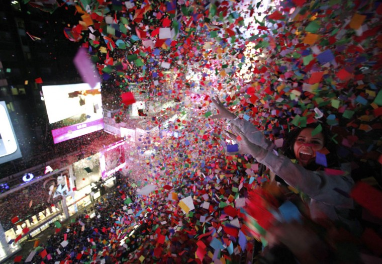 Confetti is dropped on revelers at midnight during New Year's Eve celebrations in Times Square in New York. (Gary Hershorn/Reuters photo)