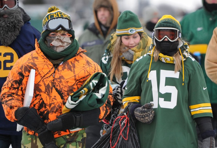Fans bundle up for the game between the Green Bay Packers and San Francisco 49ers during the 2013 NFC wild card playoff football game at Lambeau Field. (Benny Sieu/USA Today Sports)