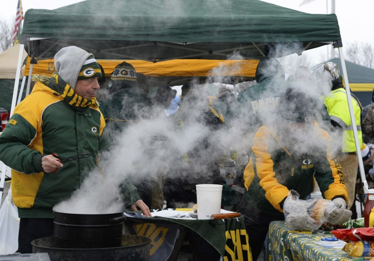 Green Bay Packer fans tailgate prior to the 2013 NFC wild card playoff football game between the Green Bay Packers and the San Francisco 49ers at Lambeau Field. (Mike DiNovo/USA Today Sports)