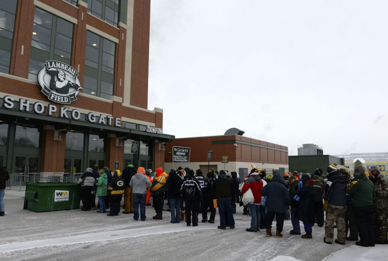 Fans wait in line to enter the stadium prior to the 2013 NFC wild card playoff football game between the San Francisco 49ers and the Green Bay Packers at Lambeau Field.(Mike DiNovo/USA Today Sports)