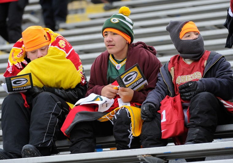 Fans sit in the stands prior to the game between the Green Bay Packers and the San Francisco 49ers during the 2013 NFC wild card playoff football game at Lambeau Field. (Benny Sieu/USA Today Sports)