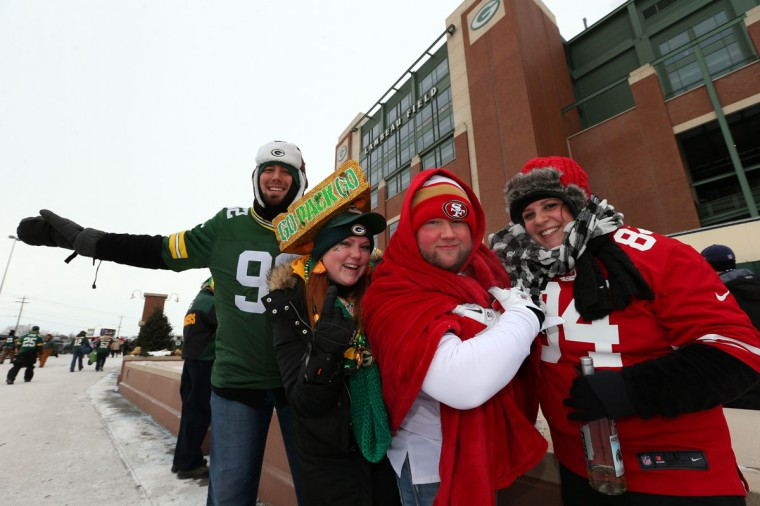 Green Bay Packers fans and San Francisco 49ers fans pose outside the stadium prior to the NFC Wild Card Playoff game between the San Francisco 49ers and the Green Bay Packers at Lambeau Field on January 5, 2014 in Green Bay, Wisconsin. (Photo by Ronald Martinez/Getty Images)