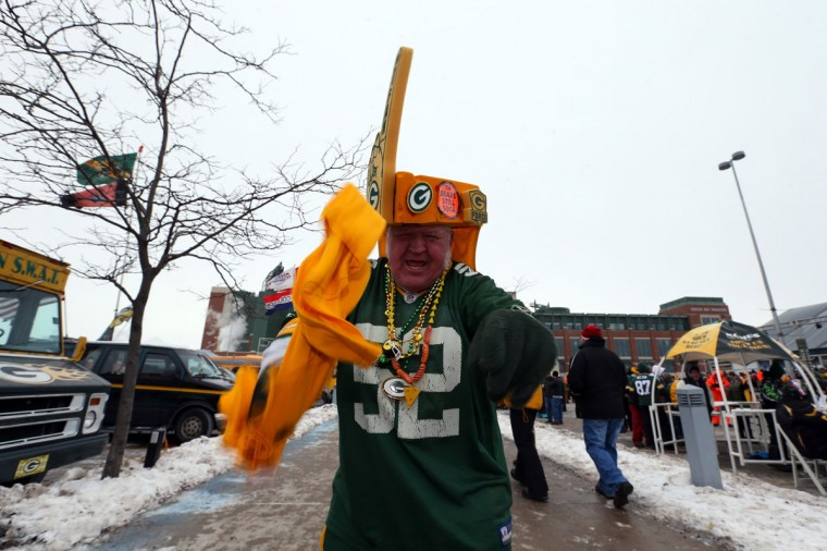 A Green Bay Packers fan cheers outside the stadium prior to the NFC Wild Card Playoff game between the San Francisco 49ers and the Green Bay Packers at Lambeau Field on January 5, 2014 in Green Bay, Wisconsin. (Photo by Ronald Martinez/Getty Images)