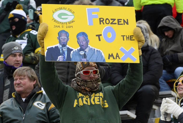 A Green Bay Packers fan holds a sign prior to the 2013 NFC wild card playoff football game between the Green Bay Packers and San Francisco 49ers at Lambeau Field. (Mike DiNovo/USA Today Sports)