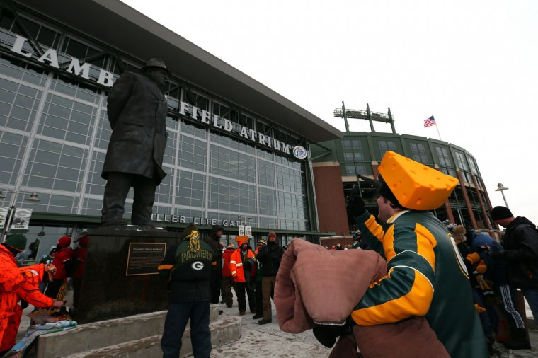 A Green Bay Packers fan takes a photo of the Vince Lombardi statue outside of the stadium prior to the NFC Wild Card Playoff game between the San Francisco 49ers and the Green Bay Packers at Lambeau Field on January 5, 2014 in Green Bay, Wisconsin. (Photo by Ronald Martinez/Getty Images)