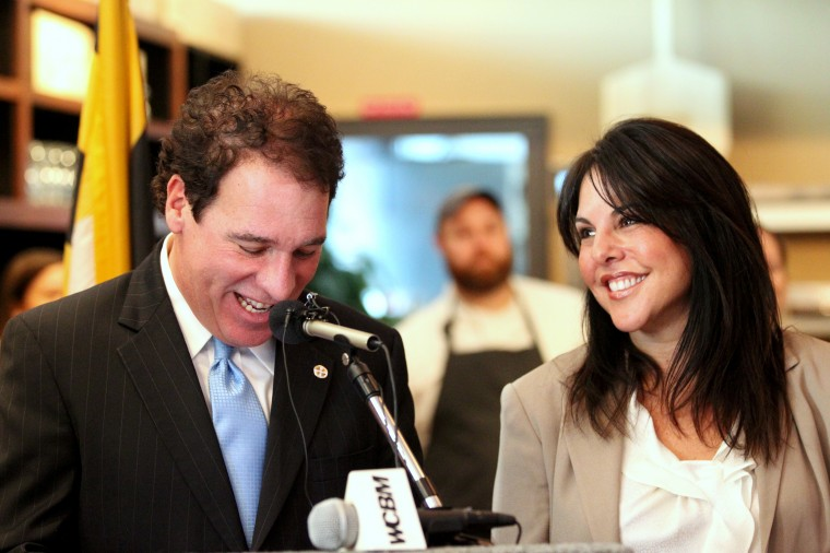 Baltimore County Executive Kevin Kamenetz jokes with his wife Jill Kamenetz during the Baltimore County's Winter Restaurant Week Kick-Off event at Liquid Lib's in Timonium on Thursday, Jan. 9, 2014. (Jen Rynda/BSMG)