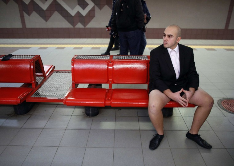 "A passenger without his pants waits for a subway train during the ""No Pants Subway Ride"" event in Sofia January 12, 2014. The event is an annual flash mob and occurs in different cities around the world, according to its organisers. (Stoyan Nenov/Reuters)"