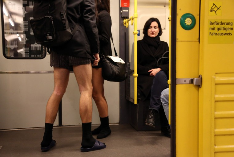 A unsuspecting subway passenger looks at participants of the No Pants Subway Ride on January 12, 2014 in Berlin, Germany. (Adam Berry/Getty Images)