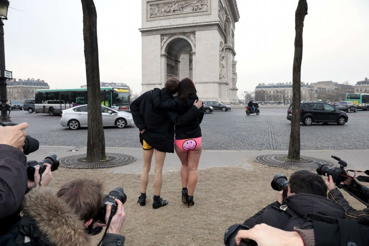 People in underwear pose in front of the Arc de Triomphe prior to take part in the 2014 No Pants Subway Ride on January 12, 2014 in Paris. (Jacques Demarthon/AFP/Getty Images)