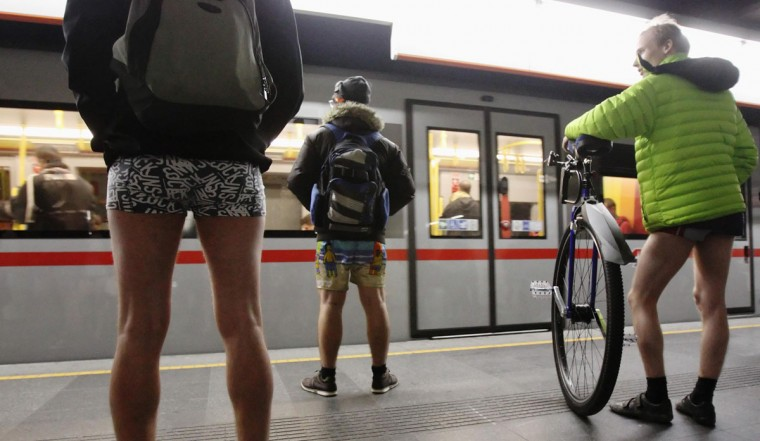 "Passengers without their pants wait on a underground platform during the ""No Pants Subway Ride"" in Vienna January 12, 2014. (Heinz-Peter Bader/Reuters)"