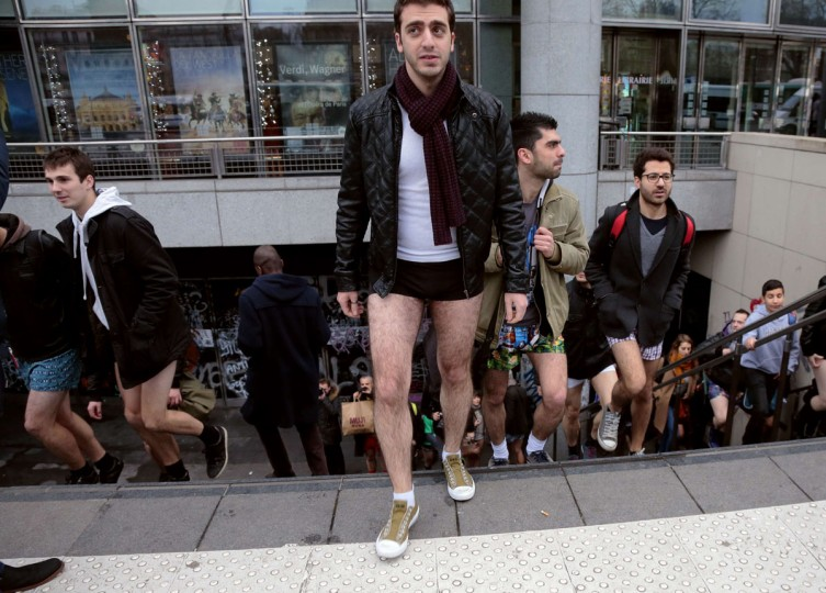 People in underwear leave a subway station in Paris, as they take part in the 2014 No Pants Subway Ride on January 12, 2014 in Paris. (Jacques Demarthon/AFP/Getty Images)