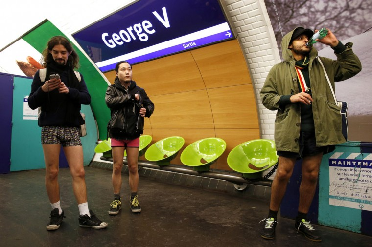"Passengers without their pants wait for a train during the ""No Pants Subway Ride"" event at a subway station in Paris January 12, 2014. (Benoit Tessier/Reuters)"