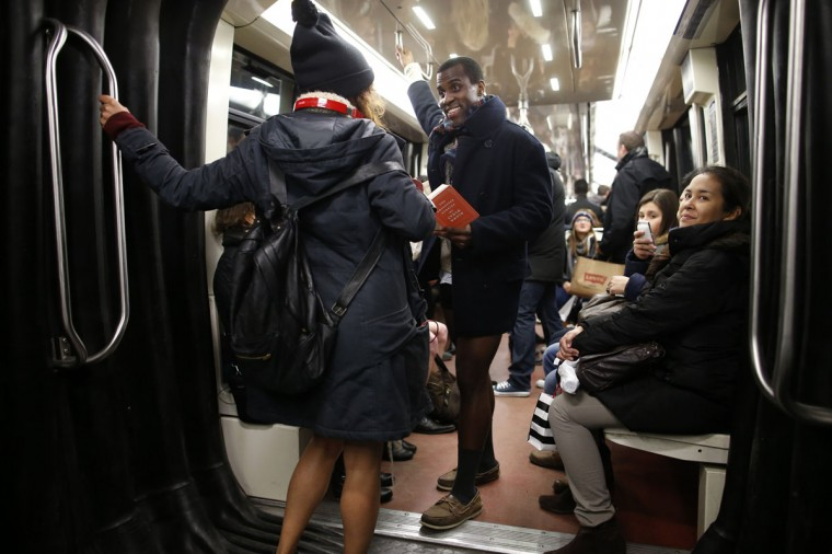 "Passengers without their pants ride a subway train during the ""No Pants Subway Ride"" in Paris January 12, 2014. (Benoit Tessier/Reuters)"