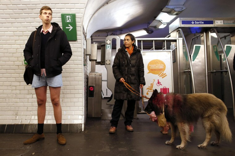 "A passenger without his pants waits for a train during the ""No Pants Subway Ride"" event at a subway station in Paris January 12, 2014. (Benoit Tessier/Reuters)"