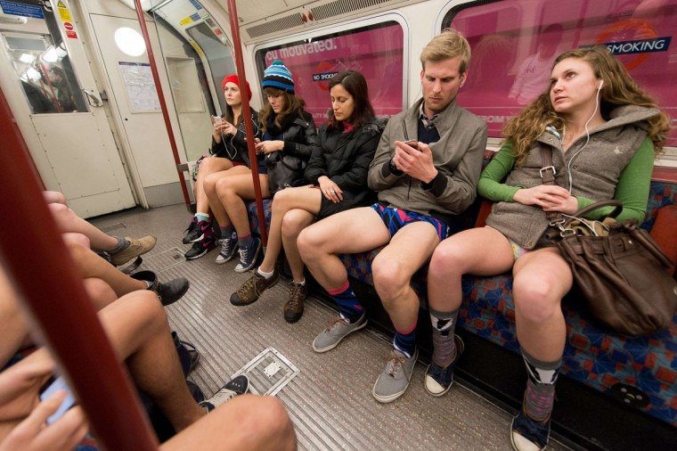 "Participants in the 13th annual International ""No Pants Subway Ride"" travel on a London underground train in London, on January 12, 2014. (Leon Neal/AFP/Getty Images)"