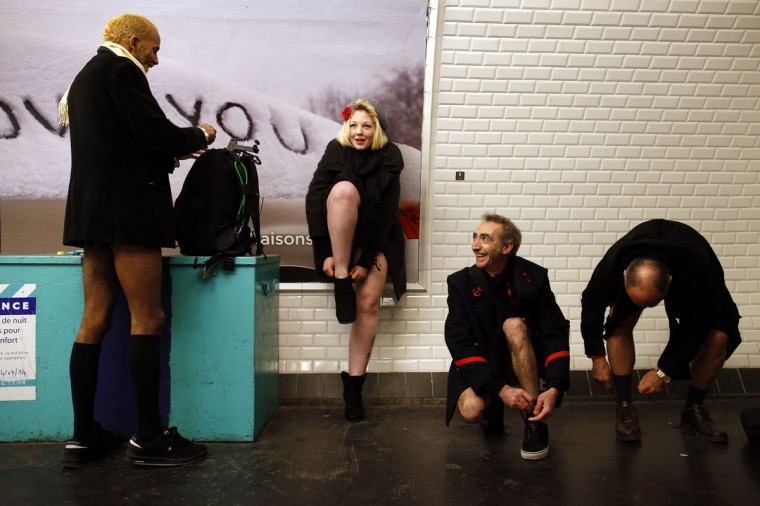 "Passengers without their pants wait for a train during the ""No Pants Subway Ride"" event at a subway station in Paris January 12, 2014. The event is an annual flash mob and occurs in different cities around the world in January, according to its organisers. (Benoit Tessier/Reuters)"