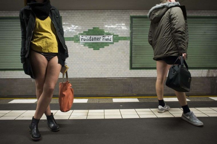 "People taking part in the ""No Pants Subway Ride"" are seen on the platform at the Potsdamer Platz station on the U2 Subway line in Berlin on January 12, 2014 . (Odd Anderson/AFP Getty Images)"