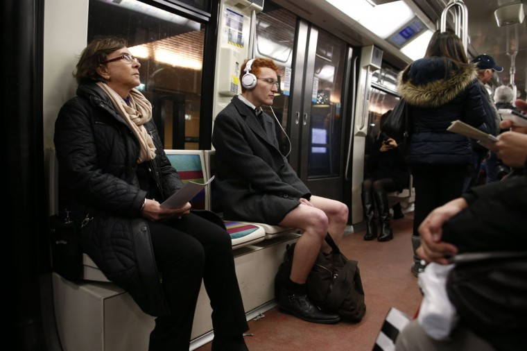 "A passenger, not wearing pants, rides a subway train during the ""No Pants Subway Ride"" in Paris January 12, 2014. (Benoit Tessier/Reuters)"