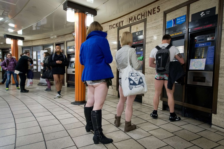 "Participants in the 13th annual International ""No Pants Subway Ride"" queue for tickets at a London underground station in London, on January 12, 2014. (Leon Neal/AFP Getty Images)"