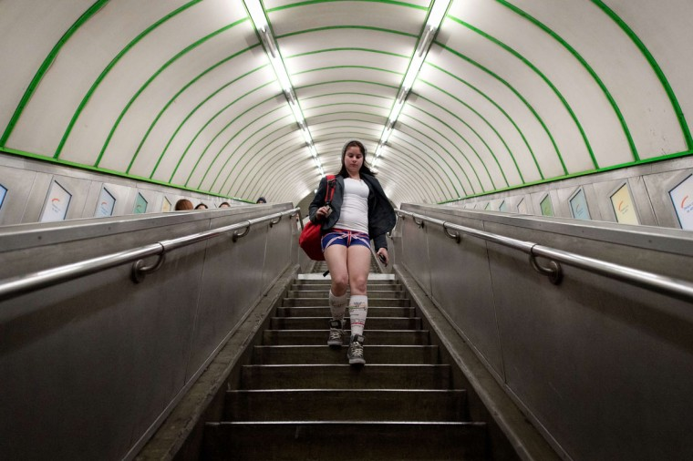 "A participant in the13th annual International ""No Pants Subway Ride"" enters a London underground station in London, on January 12, 2014.(Leon Neal/AFP Getty Images)"