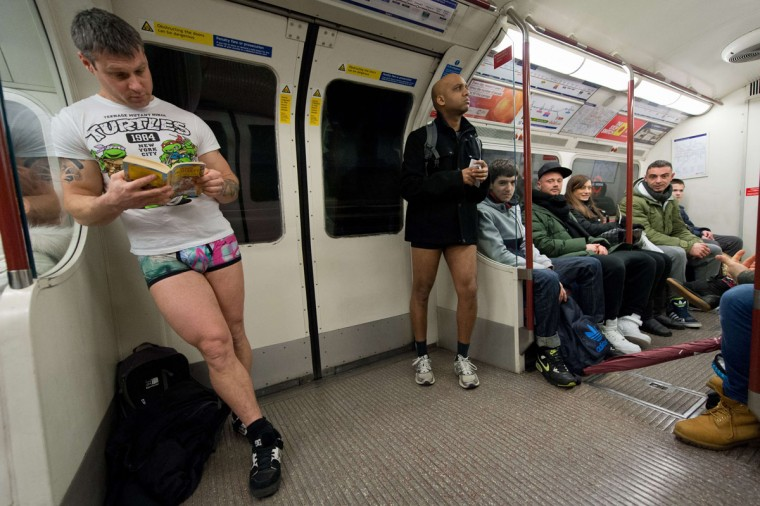 "Participants in the 13th annual International ""No Pants Subway Ride"" travel on a London underground train in London, on January 12, 2014. (Leon Neal/AFP Getty Images)"