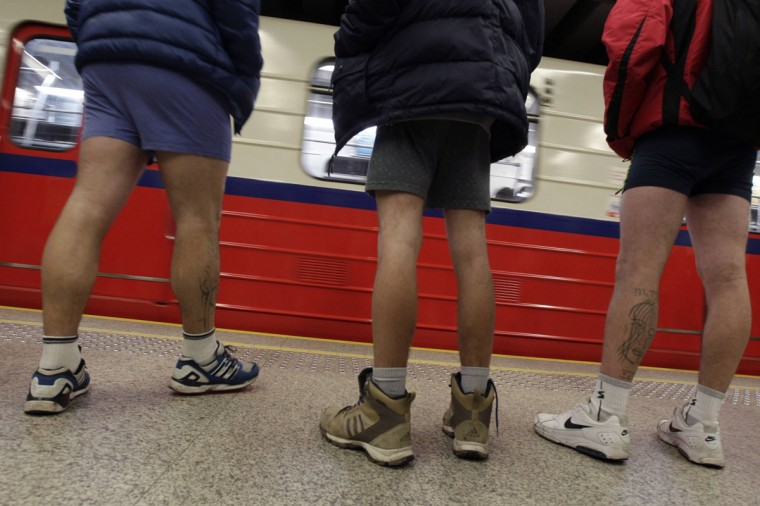 "Passengers without pants wait for a subway train during the ""No Pants Subway Ride"" event in Warsaw January 12, 2014. (Kacper Pempel/Reuters)"