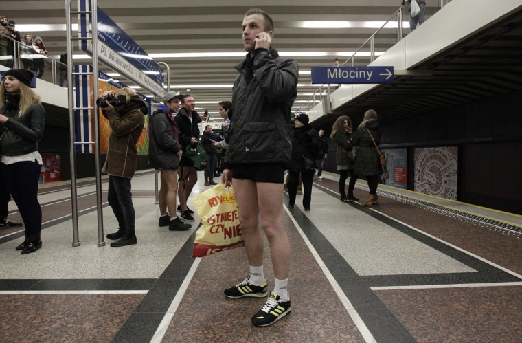 "A passenger without his pants waits for a subway train during the ""No Pants Subway Ride"" event in Warsaw January 12, 2014. (Kacper Pempel/Reuters)"