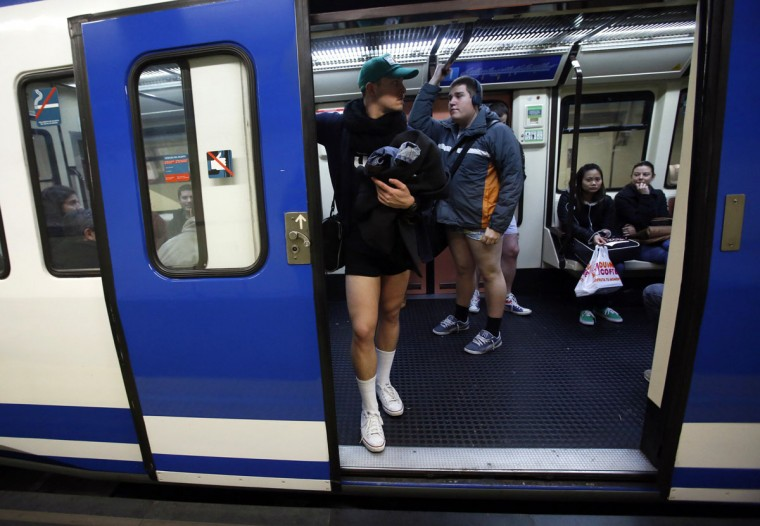"Passengers without their pants stand inside a train during the ""No Pants Subway Ride"" event at a subway station in Madrid January 12, 2014. (Sergio Perez/Reuters)"