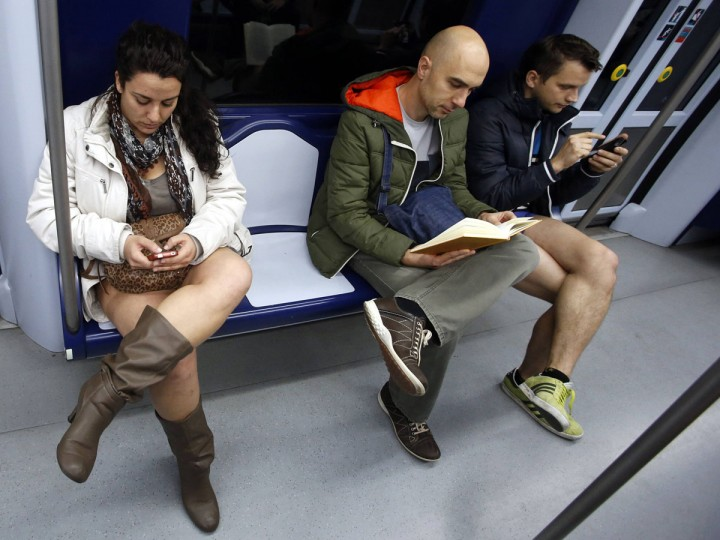 "Passengers without their pants sit inside a train during the ""No Pants Subway Ride"" event at a subway station in Madrid January 12, 2014. (Sergio Perez/Reuters)"