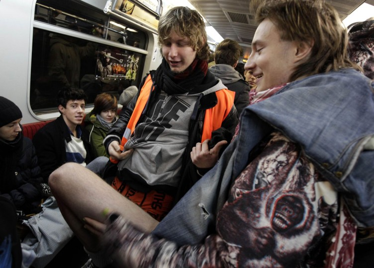 "A passenger without his pants rides a subway train during the ""No Pants Subway Ride"" event in Warsaw January 12, 2014. The event is an annual flash mob and occurs in different cities around the world, according to its organisers. (Kacper Pempel/Reuters)"