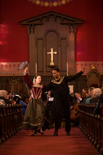 """Omari Contaste, 21, right, and Desiree Koomtz-Nachtrieb, perform a dance down the aisle during the song """"España"""". (Nate Pesce/BSMG)"""