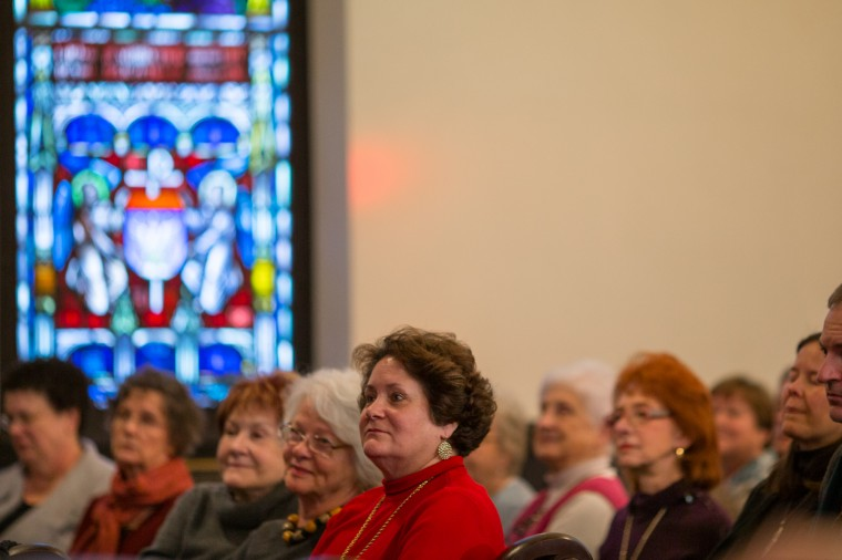 Guests listen during the orchestra concert at St. John's Episcopal Church. (Nate Pesce/BSMG)