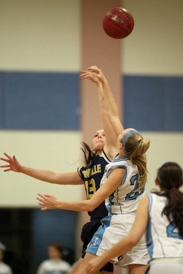 Catonsville's Taylor Barton, back, goes up against Mount de Sales' Amanda Seidl, right, for the jump ball at the start of the girls basektball game at Mount de Sales Academy in Catonsville on Tuesday, Jan. 14, 2014. (Jen Rynda/BSMG)