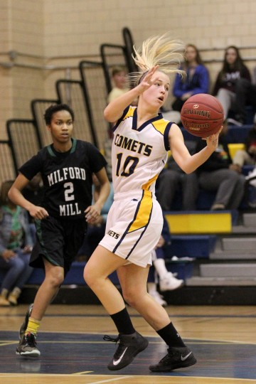 Catonsville's Renee Gast moves the ball during the girls basketball game against Milford Mill at Catonsville High School on Wednesday, Jan. 15, 2014. (Jen Rynda/BSMG)