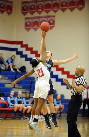 Centennial's Brittany Anderson and Howard's Sydney Biniak compete for the opening tipoff during a girls basketball game at Centennial High School on Friday, Jan 17. (Brian Krista/BSMG)