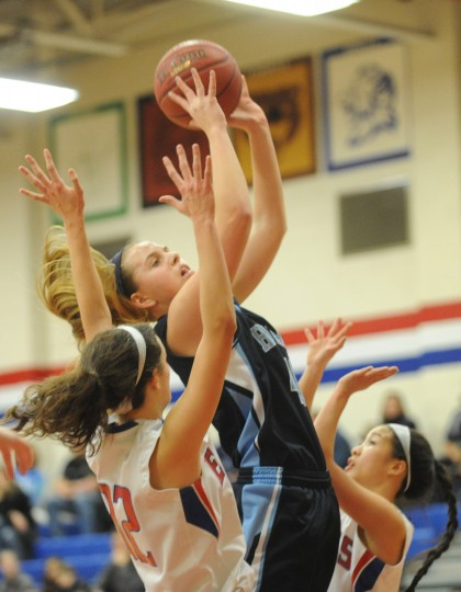 Howard's Sydney Biniak, cetner, releases a shot as she's defended against by Centennial teammates Kimmy Eads, left, and Alicia Hsieh during a girls basketball game at Centennial High School on Friday, Jan 17. (Brian Krista/BSMG)