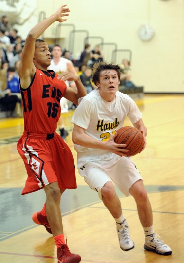North Harford's Brett Hurley drives to the hoop as Edgewood's Immanuel Gladden-Stokes looks to make a a block during Friday night's game at North Harford. (Matt Button/Aegis staff)